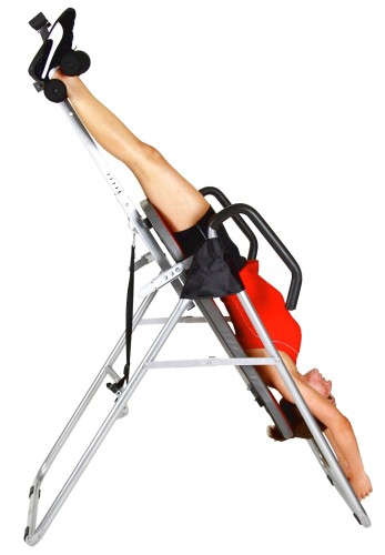 Benefits-Of-Inversion-Table-For-Back-Pain-with-women-wearing-red-are-turned-over-with-his-head-under-the-body