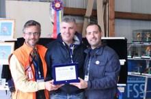 Fabio Macchioni (centre) receives a trophy to commemorate his gold medal at the 2016 World Show from Antonio Petraroli and Guglielmo Carillo