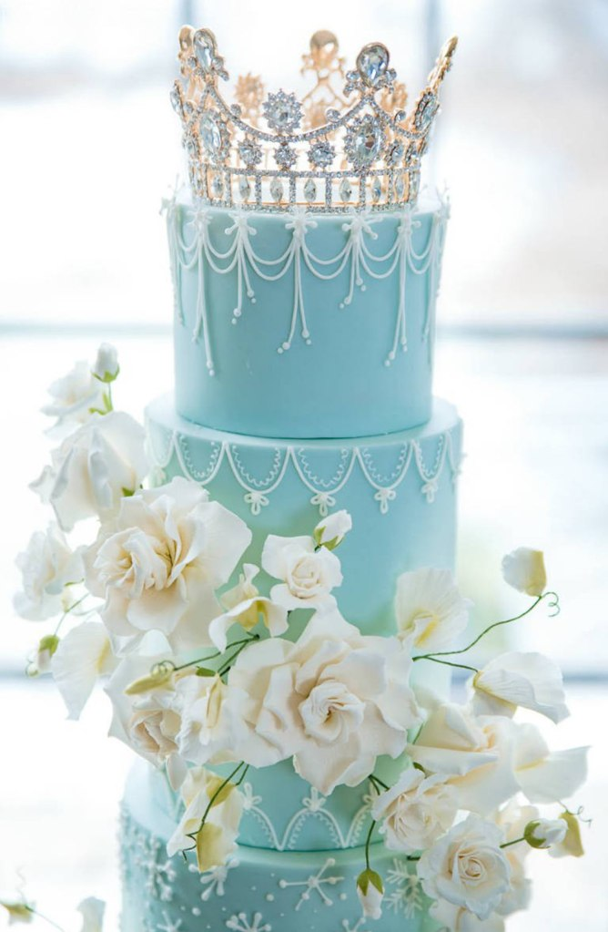 Frozen wedding cake with princess tiara and sugar flowers in Toronto Canada
