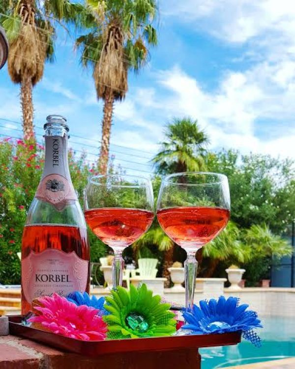 Electric Daisy Carnival Sparkling Rose for poolside recovery.