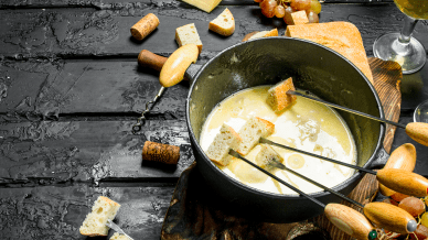 delicious-fondue-cheese-with-white-wine-on-black-rustic-table.jpg-1