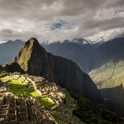 Mach Picchu at sunset with rainbow