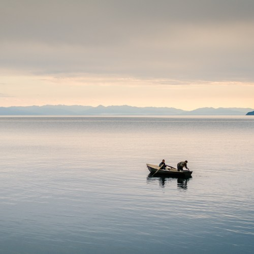 Fishermen on the Lake Baikal in Russia at sunset