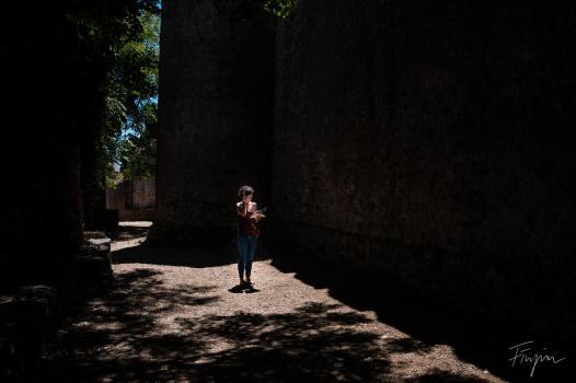 girl castle portugal shadow light