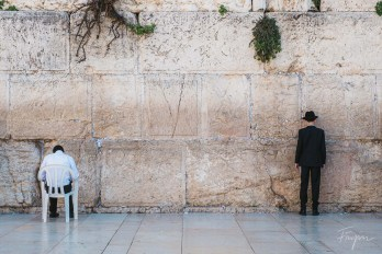 Two boys praying at the Western Wall in Jerusalem