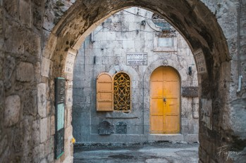 A yellow door and window in the Armenien quarter in the old Town of Jerusalem