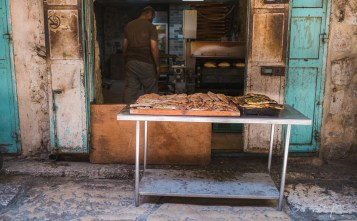 Freshly baked bread on a table in front of an old bakery in Jerusalem