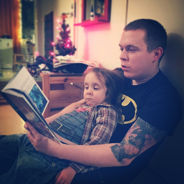 Reading our book to my son, 2014.