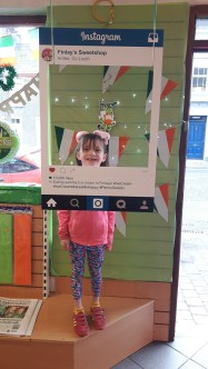 Lilly May trying out our new Instagram sign