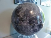 Moon globe made using 15,000 Lunar Reconnaissance Orbiter photos; shows all unmanned and manned landing sites