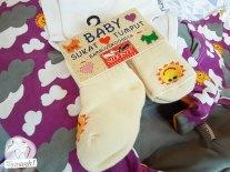 Babybox: Stocken und Handschuhe