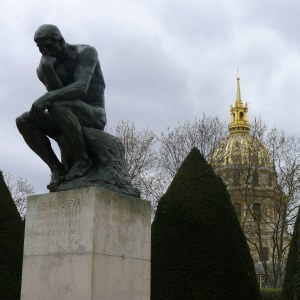The Thinker with Les Invalides behind it.