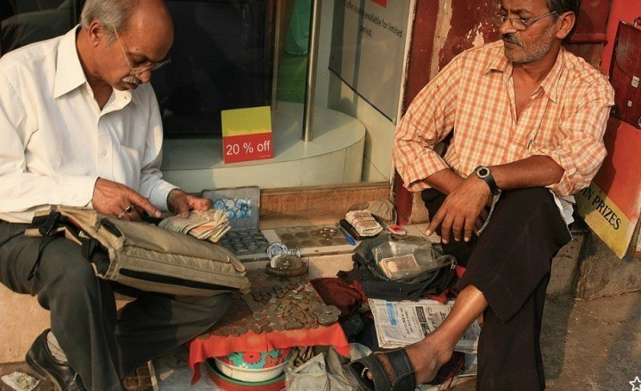 Photo credit: carol mitchell. Roadside banking in Chandni Chowk, Delhi