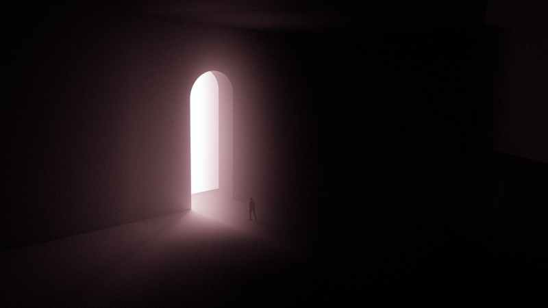 silhouette of person standing near a doorway with bright light