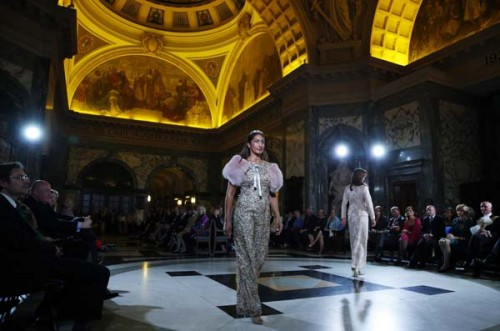Models present creations by designer Sue Bonham, part of the first collection of her new company With Conviction Ltd at the Old Bailey courthouse in London