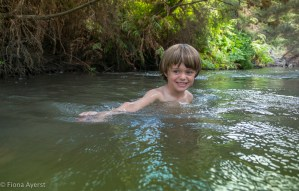 having some fun in the river below the thermal pool