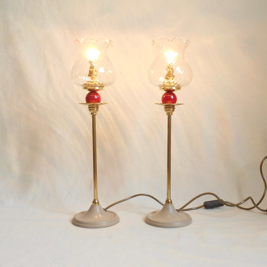 A pair of brass lamps  ●