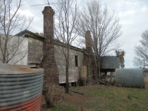 Once warm, now the chimneys stand strangely firm and cold like soldiers unable to stop the decay around them.