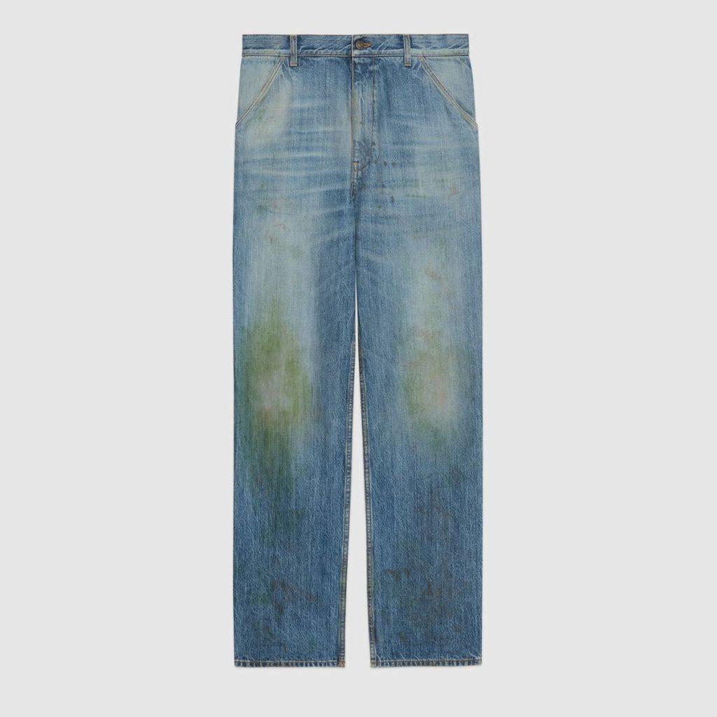 jeans macchiati d'erba di Gucci
