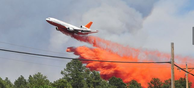 DC-10, Tanker 911, dropping on Black Forest Fire