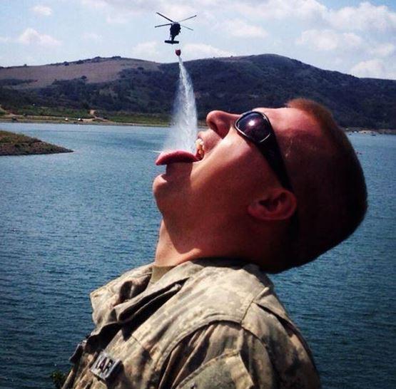 Blackhawk dropping water