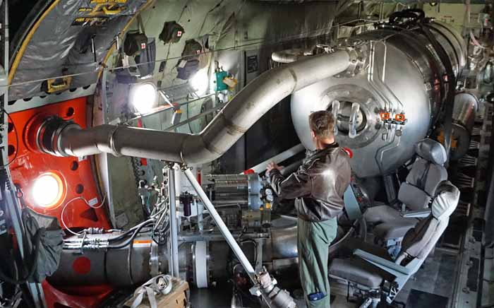 Lt. Col. Alan Brown inside a Wyoming Air National Guard C-130 with a MAFFS unit. Photo by Bill Gabbert, April 30, 2014.