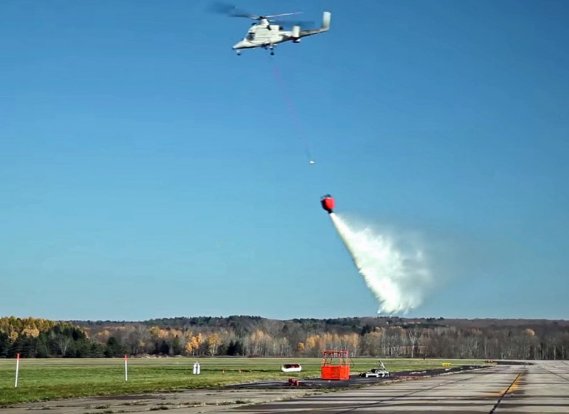 Remotely piloted K-MAX drops water
