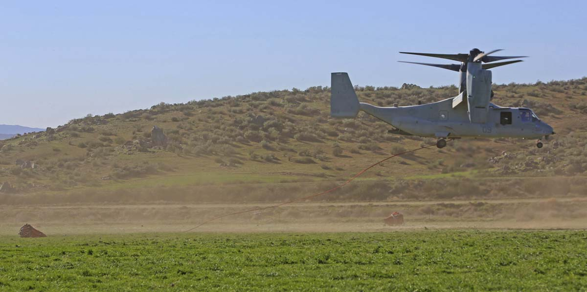 MV-22 Osprey drops water on simulated wildfire