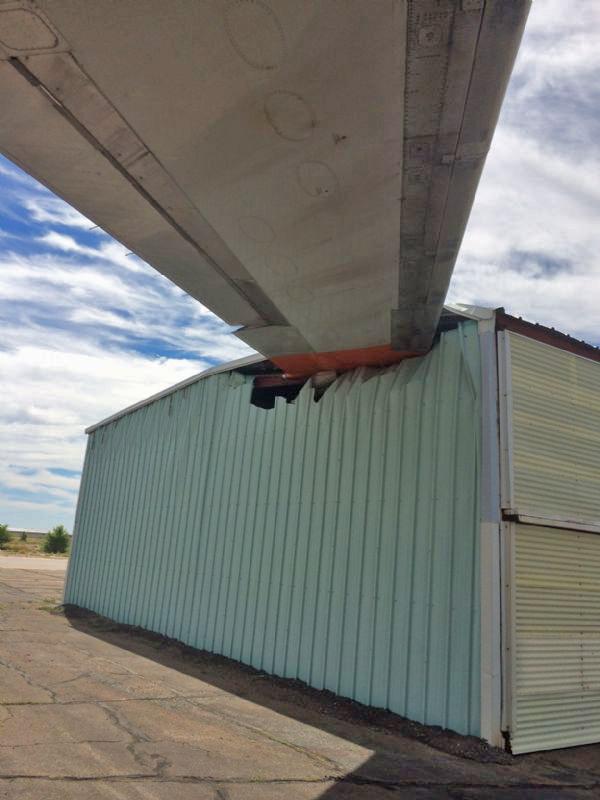 DC-10 wing into hangar