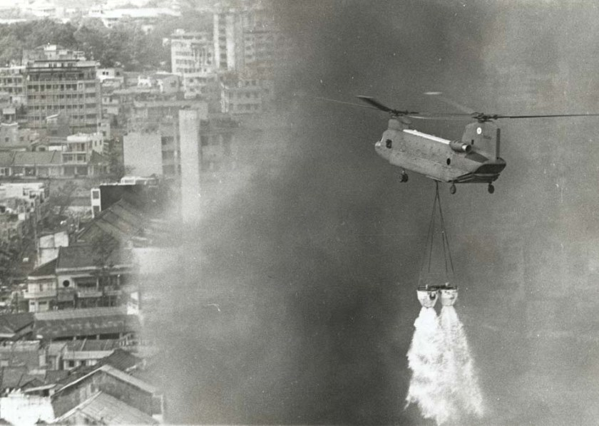 Helicopter Chinook water bucket Vietnam 1970 structure fire