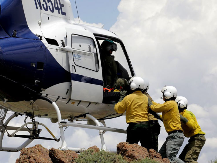 firefighter injured helicopter extraction