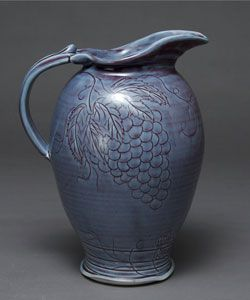 Pitcher with carved grapes