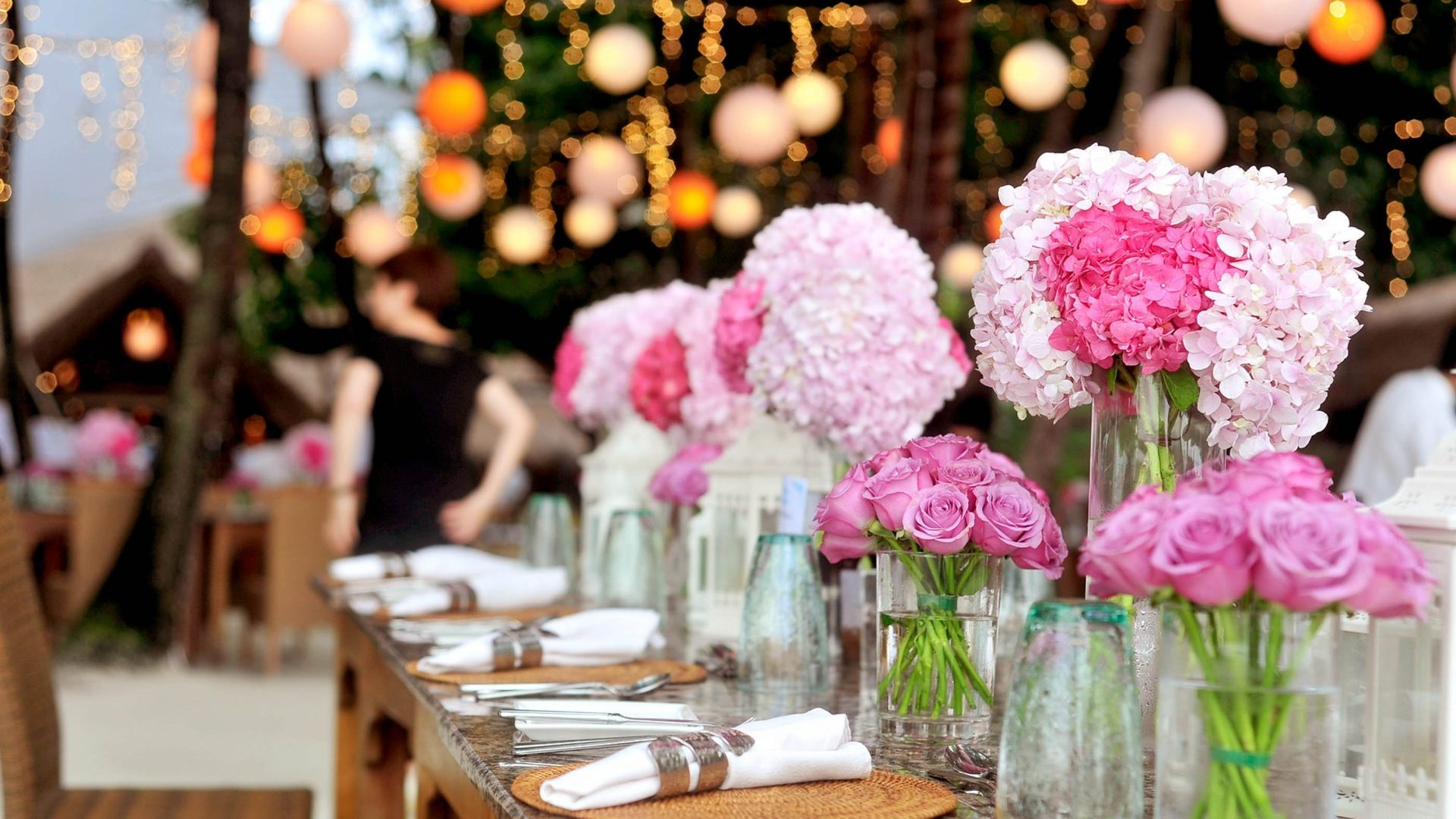 Floral arrangement on table with soft lights in background