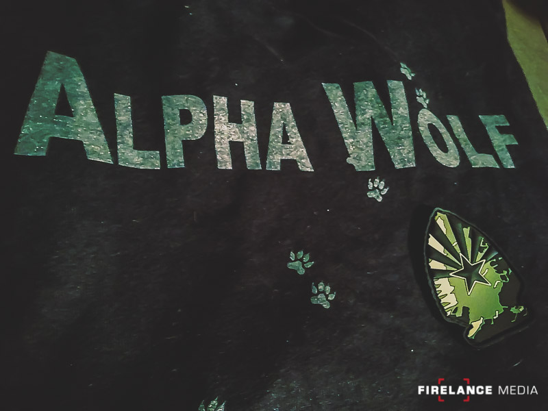 The Alpha Wolf shirt and Greenside Training Patch. Both must be earned.
