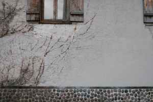 brown wooden window frames on white concrete wall