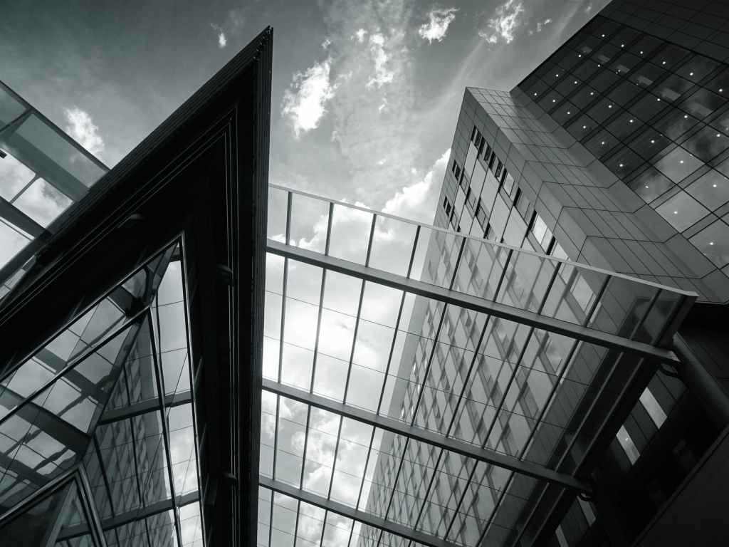 grayscale of glass building