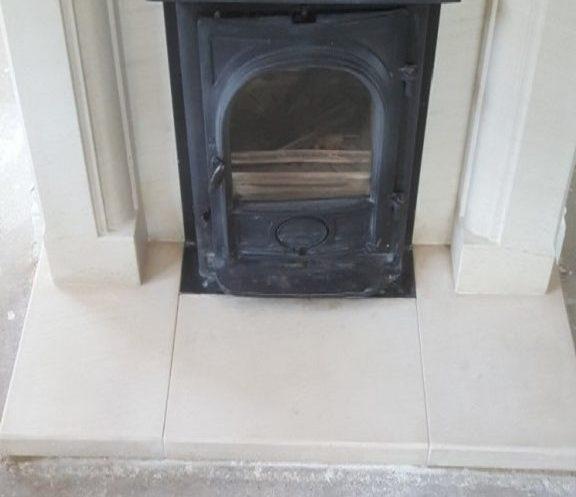 a limestone fireplace hearth