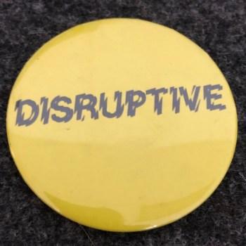 Yellow Disruptive badge