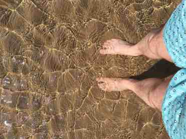 Findhorn beach in the sunshine August 2017 with James feet in the water