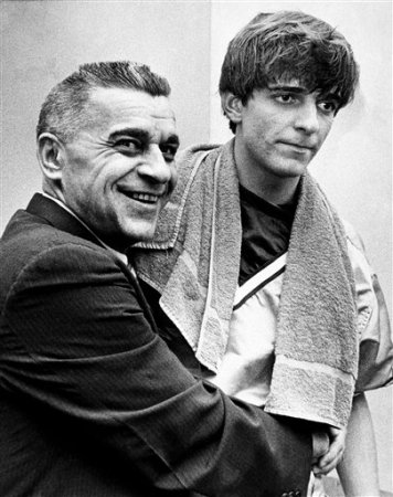 Louisiana State University basketball coach Press Maravich embraces his son Pete Maravich and asks photographers if they wanted him to kiss Pete after he broke the all-time college scoring record in Baton Rouge Saturday, Feb. 1, 1970. (AP Photo)