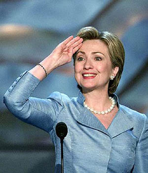 Original caption: New York Senate candidate and U.S. first lady Hillary Rodham Clinton salutes the delegates during the first day of the Democratic National Convention at the Staples Center in Los Angeles, August 14, 2000. Democrats opened their four-day national convention with a program stressing the nation's