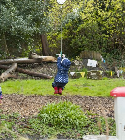 child playing on zip wire
