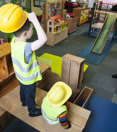 children building one child sitting down