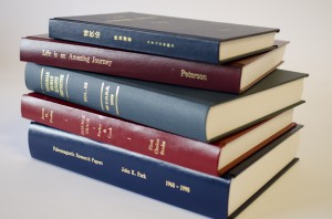 Hard cover book printing using fabric and leather-style casing with foil stamped titles