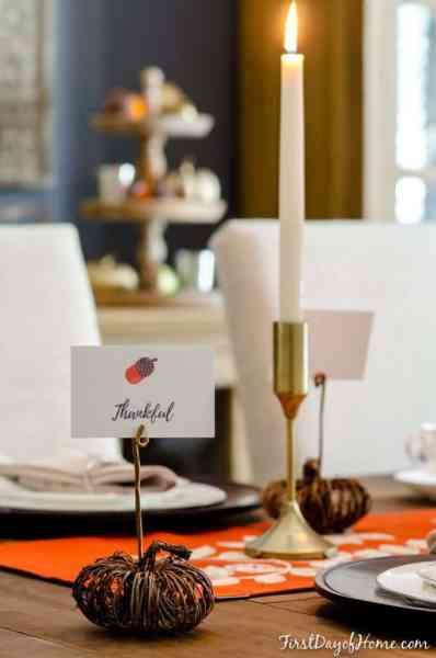 Final DIY pumpkin place card holder on Thanksgiving table