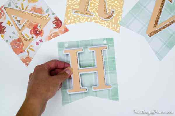 Assembling letters and pennants of banner