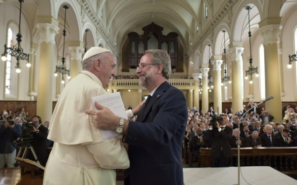Pope Francis shook hands with Eugenio Bernardini, moderator of the Waldensian Church, during the first-ever visit of a pope to the Waldensian evangelical church in Turin Monday. (L' Osservatore Romano/Pool Photo via AP)