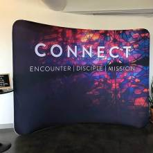 https://www.churchbanners.com/indoor-solutions/tension-backdrop-display-curve/