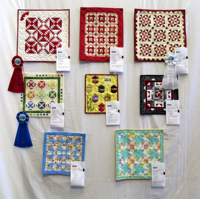 wall of mini quilts OCQG Aug 2016