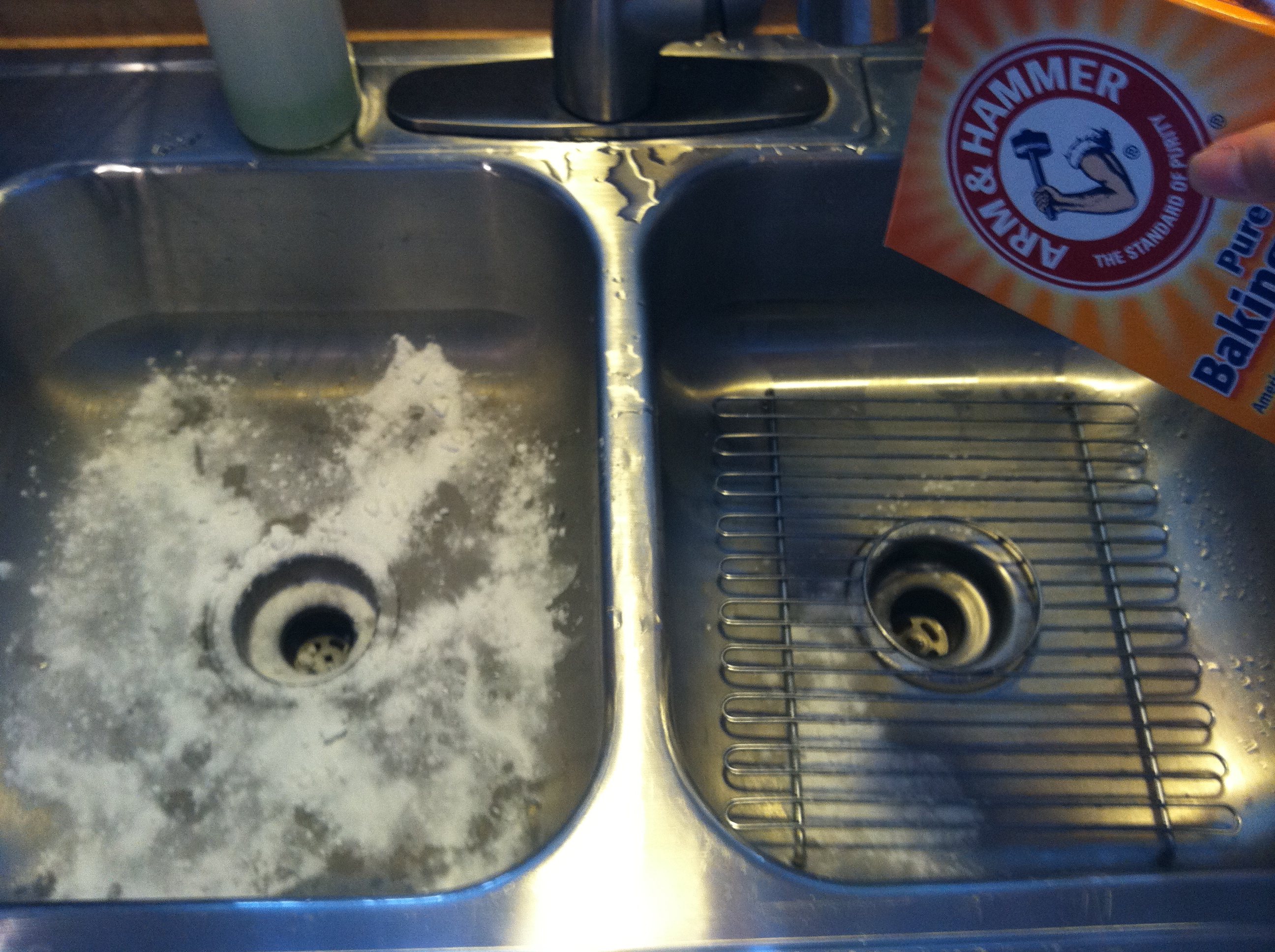 clean your kitchen sink with lemons